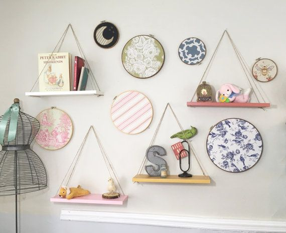 These handmade hanging shelves (set of 4) are the perfect piece for a childs room or any space that needs a touch of color. Pictured here in Victorian Pink, Salmon Coral, Mustard, and Snow White with a Solid color finish, they are also available in any finish or color, making them a great fit in any room of the house, in any decor. Hung with natural jute, they have a unique, rustic charm. Theyre designed to be adjustable so that hanging and leveling them is a snap - these shelves can be…