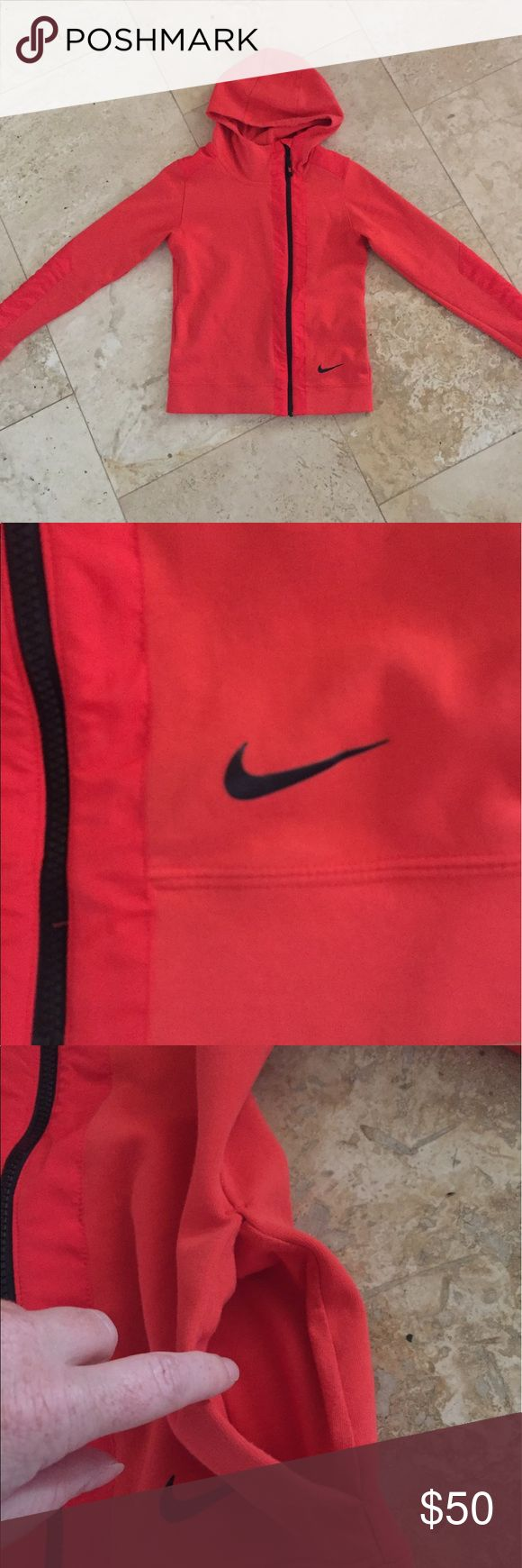 Nike hoodie Red Nike hoodie with pockets. Zips high up the neck. It is too small for me- was a gift. No tags but never worn. Nike Jackets & Coats