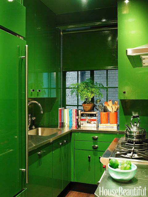 The kitchen is small, but Tom Mendenhall has no trouble making braised short ribs for eight in it. Cabinets are lacquered in Bamboo Leaf by Fine Paints of Europe, as was the roller shade by Manhattan Shade & Glass, which erases an exhaust unit. Even the Sub-Zero refrigerator is painted green.
