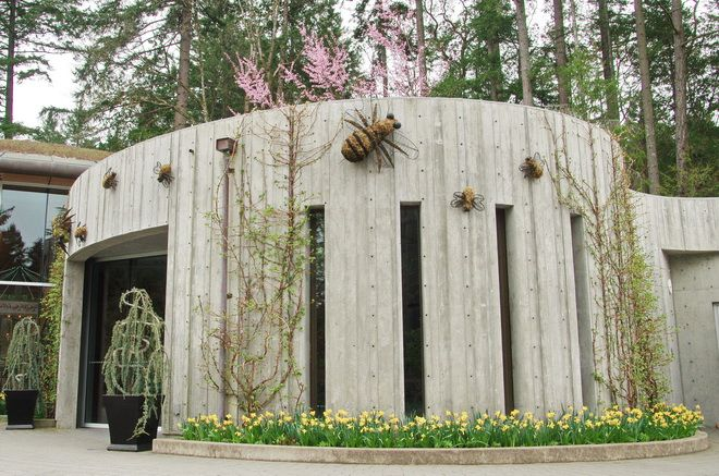 """""""The Merry Go Round is housed inside this building - covered with mossy bumblebees""""  #butchartgardens #explorevictoria #gardens #flowers"""