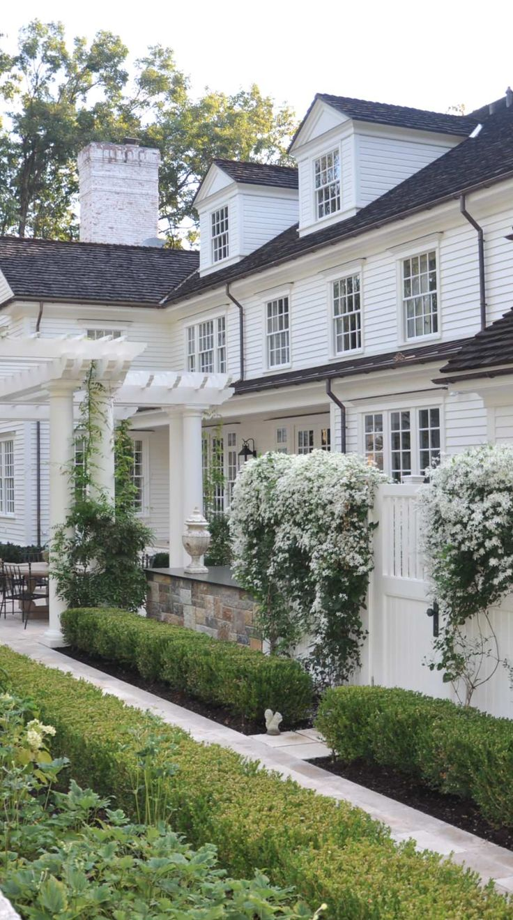 white house, black roof and accents (including gutters) also with green & white landscaping- EXACTLY what I have planned, and it is gorgeous!