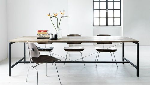 contemporary dining table in wood and metal by VIPP