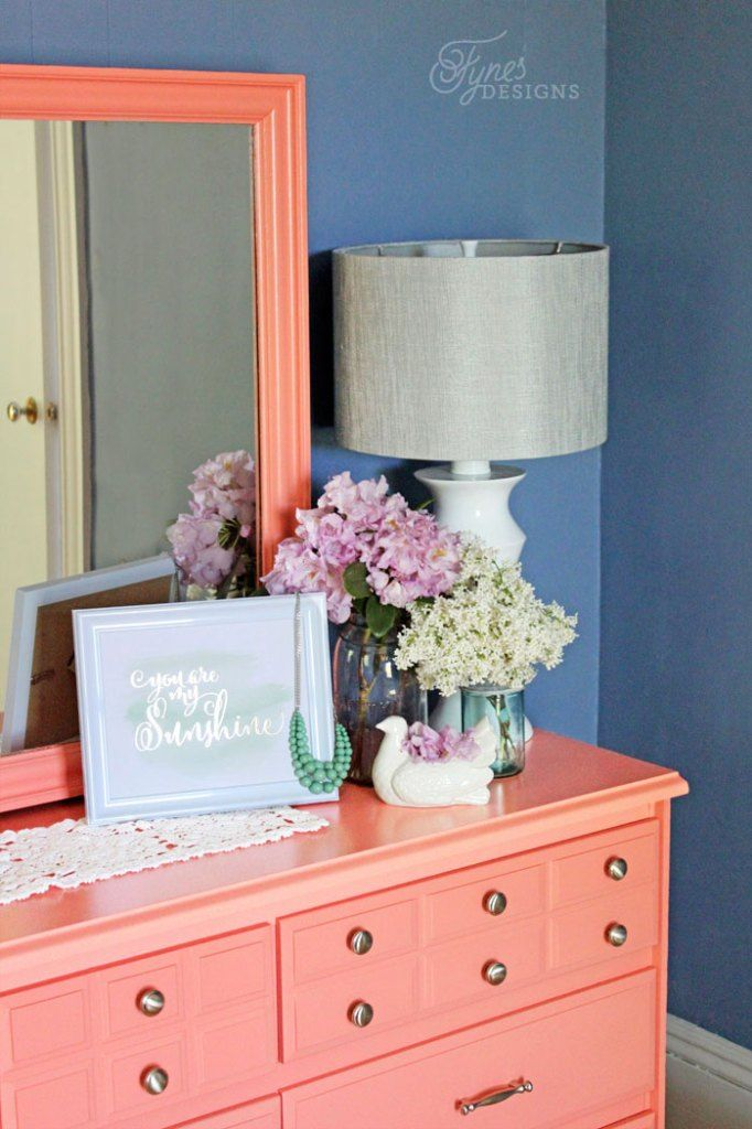 Fresh coat of paint gives this dated dresser a major update . A must see beautiful Coral painted dresser