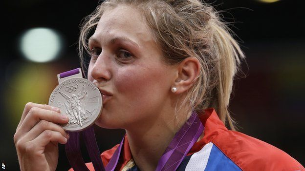 Olympics judo: Gemma Gibbons puts silver lining on judo showing.  While most of the crowd remained trained on Gibbons, Harrison, the first American to win judo gold at an Olympics, clambered into the crowd to share the moment with coaches, support staff and loved ones.