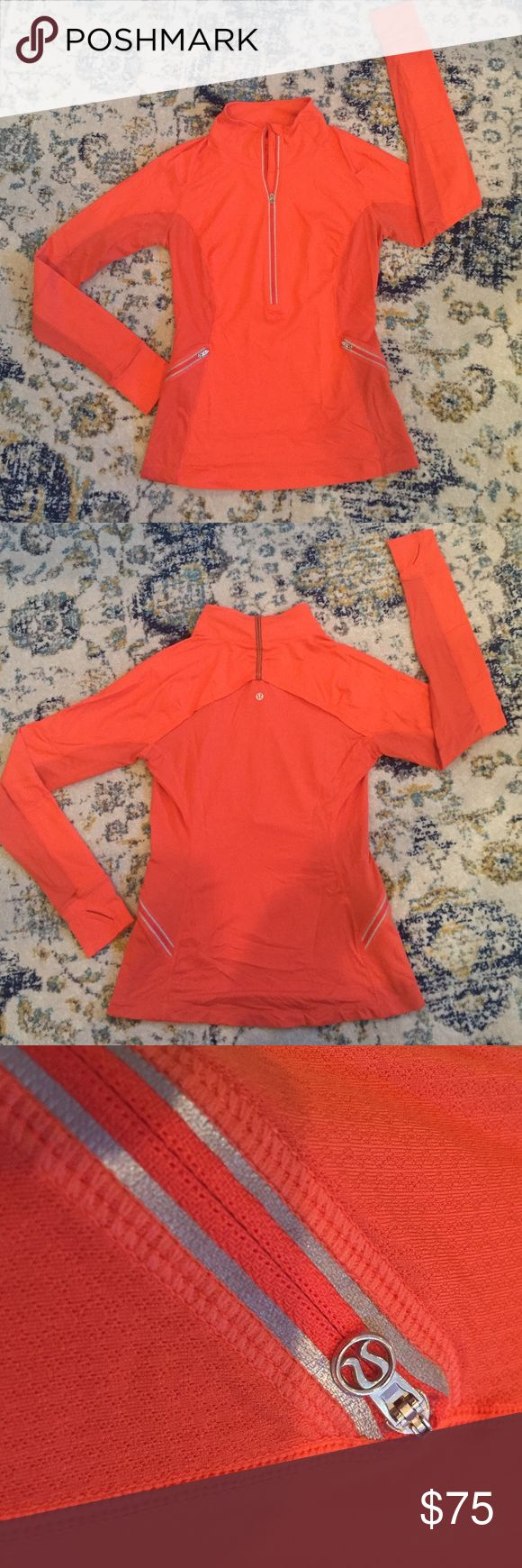 Lululemon pullover Orange pullover with two zip up pockets, thumb holes, and a breathable mesh back.. only worn a few times & in great condition! lululemon athletica Tops Tees - Long Sleeve