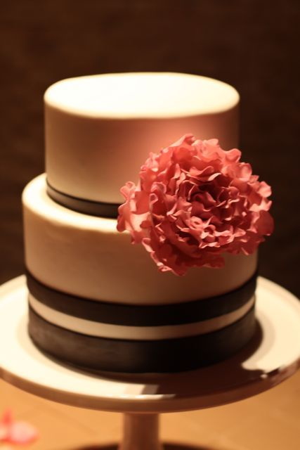 small two tier round cake with flower :)