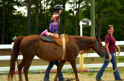 Horses provide therapy for special needs kids