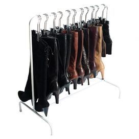 """Effortlessly stow up to 10 pairs of boots with this essential rack, showcasing a white finish and free-standing design.    Product: Boot rackConstruction Material: MetalColor: White and silver Features:  Holds up to 10 pairs of bootsThree hangers includedFree-standing design   Dimensions: 34.5"""" H x 33.5"""" W x 17.75"""" D"""