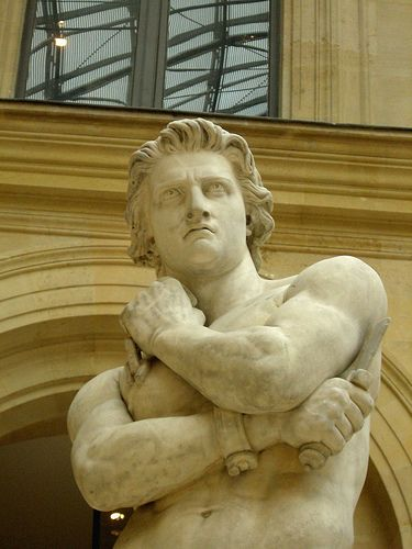 This is a close-up of a sculpture of Spartacus at the Louvre Museum in Paris.