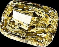 The Golden Eye Diamond: The world's largest flawless Canary Yellow diamond. Its original uncut 124.5-carat state. This particular type of diamond - a fancy intense yellow - accounts for less than 0.1 percent of all natural diamonds, so you can imagine how rare one this size is. The gem was cut to a still-huge 43.51 carats and somehow became entangled in a drug dealing and money laundering ring in Ohio, which was busted in 2006. As a result, the unusual jewel became property of the U.S…