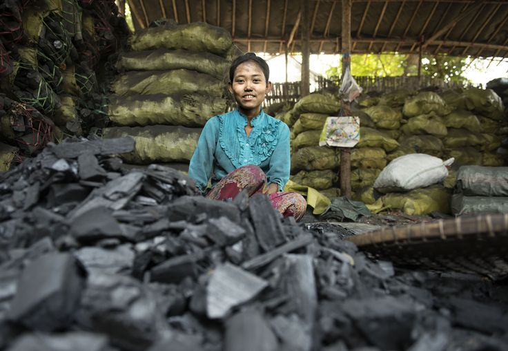 This girl along with her whole family was working in a place where they cut big pieces of charcoal into small ones and then pack them into sacks. (2/3 photos).  Charcoal workers - #Mandalay, #Myanmar