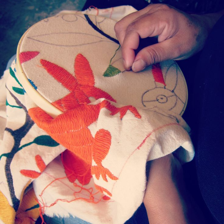 Otomi embroiderer working on a custom Olli Lounger
