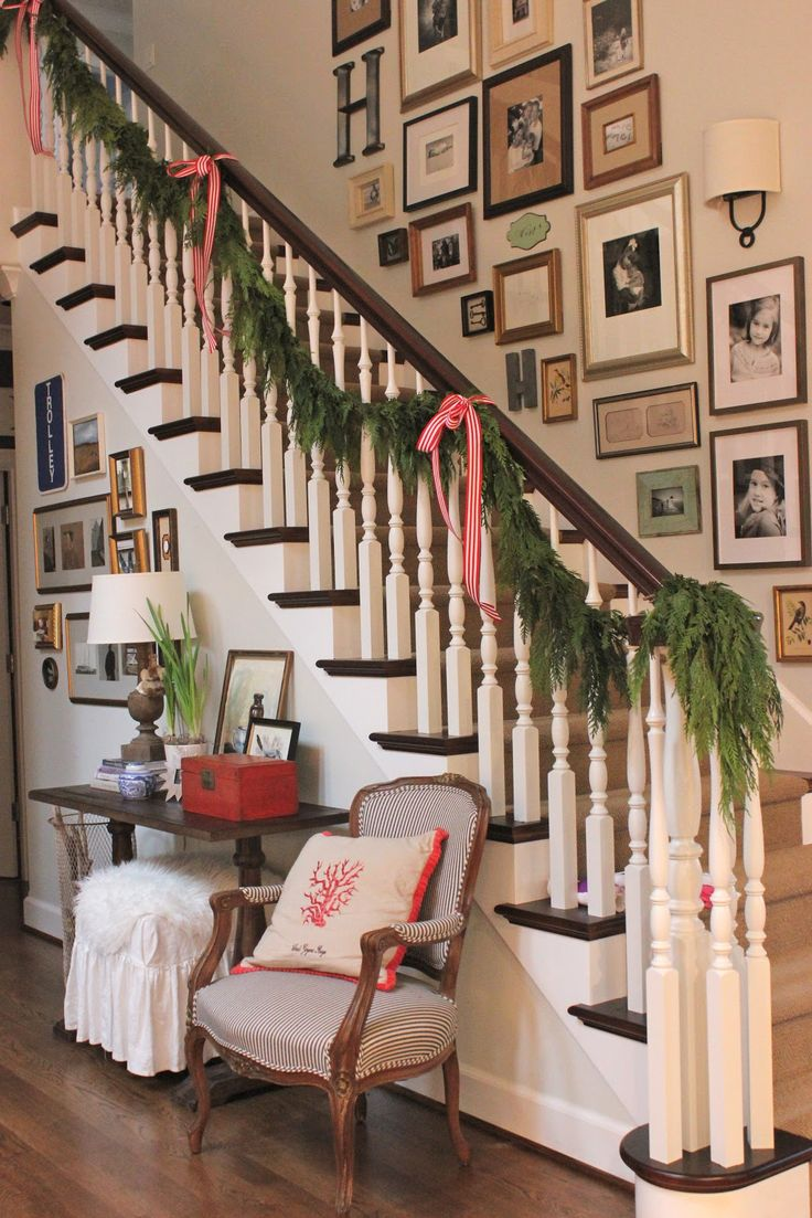 love the chair and gallery wallsStairs, Staircas Design, Pictures Display, Gallery Walls, Photos Wall, Frames Gallery, Christmas Garlands, Families Pictures Wall, Christmas Staircases