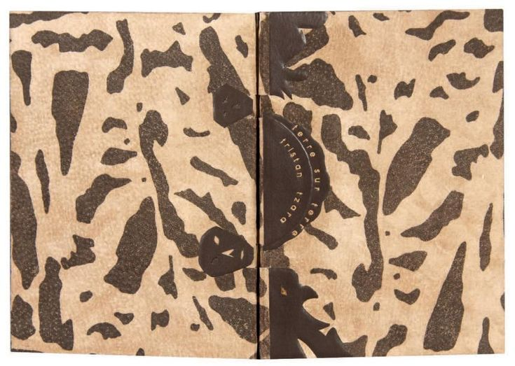 TZARA Tristan. MASSON André  TERRE SUR TERRE. Paris, Editions des 3 Collines, 1946. In-8, plein daim façonné, pièce de Box chocolat portant dans un décor géométrique le titre sur le premier plat, dos lisse, coutures apparentes, doublures de nubuck beige, couverture et dos conservés, chemise titrée, étui. (Antonio P.N.).
