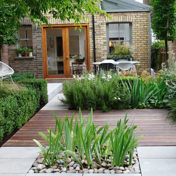 Break up your garden with decking, concrete and decorative stones for a sleek modern look