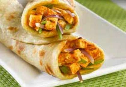 Indian cottage cheese and tasty veggies are marinated in curd mixture and wrapped in Indian roti.