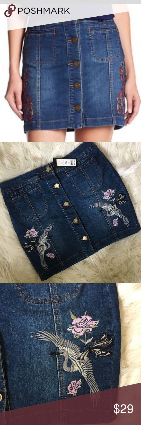 """NWT jean skirt NWT Women's jean Button skirt size medium with beautiful bird and flower embroidered on the side. Top to bottom is about 16"""". Waist is 15"""". Romeo & Juliet Couture Skirts Mini"""