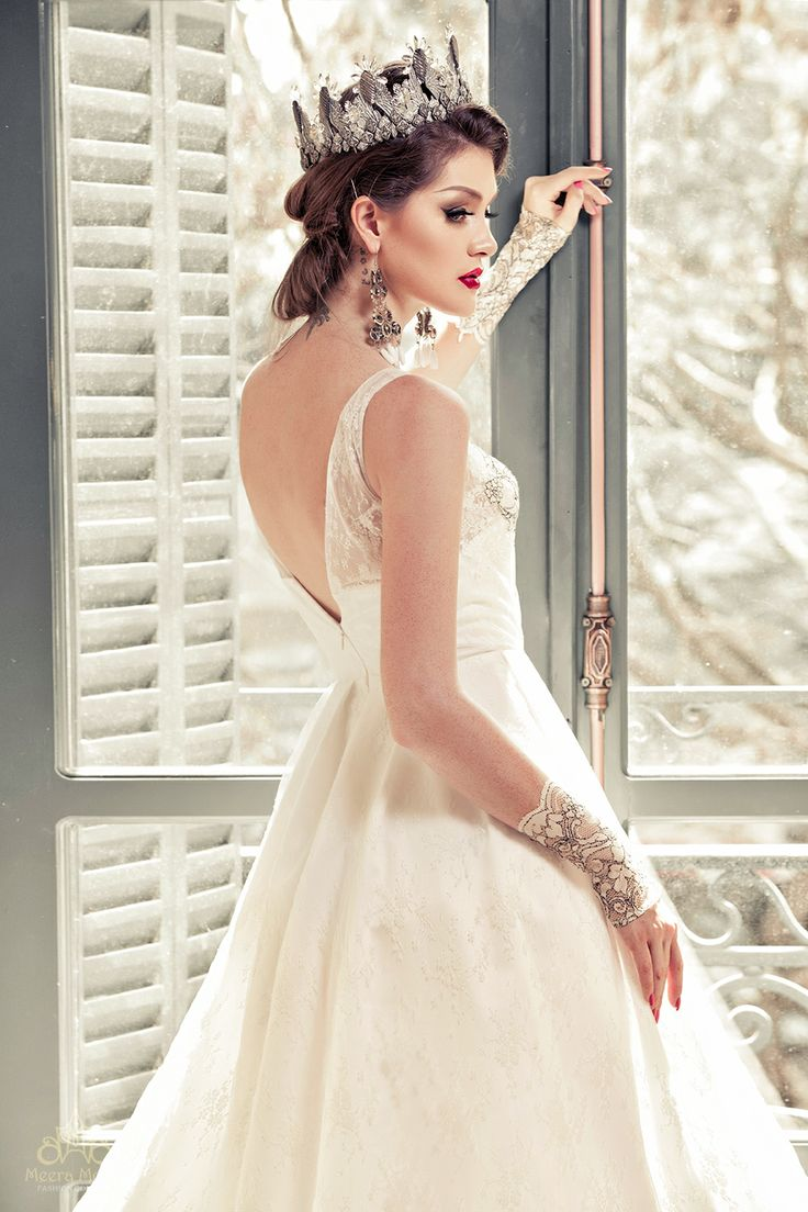 Sleeveless A-line gown with flowing impeccable cut, illusion neckline and V-back. See more at: http://www.weddinginspirasi.com/2013/12/05/meera-meera-fall-2013-wedding-dresses/