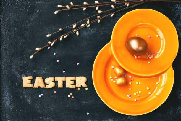 easter holiday background orange plate golden eggs