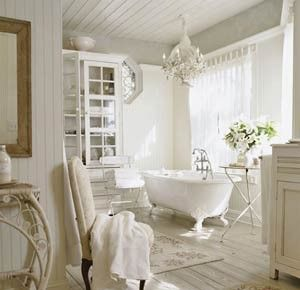 Photo On Elegant bathroom with vintage claw foot tub and rustic plank flooring White beadboard walls and ceiling with crystal chandelier Gracious Interiors