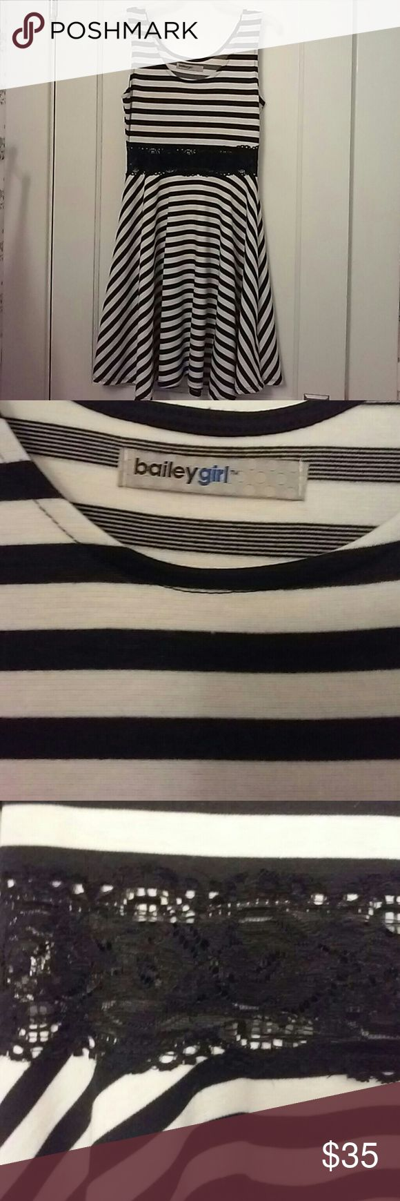 Baileygirl stripped junior dress size M Very nice summer dress. Black and white stripes. Slip over head. CHECK out the waistline...see through black lace with ample stretch. Measurement from shoulder to waist is 34 inches. 90%polyester and 10% spandex. Hand wash...already laundered. Gently used. Bailygirl Dresses Midi