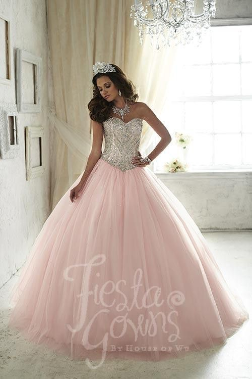Simulated crystals expound the inherent beauty in this ball gown with a basque waist and sweetheart neckline. Download the Fiesta Gowns by House of Wu sizing chart here. *Note lead times for dresses w