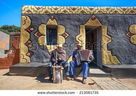 GOLDEN GATE - AUGUST 24: Basotho musicians performing for visitors on August 24, 2014 in Basotho Cultural Village, Golden Gate National Park, Free State, South Africa