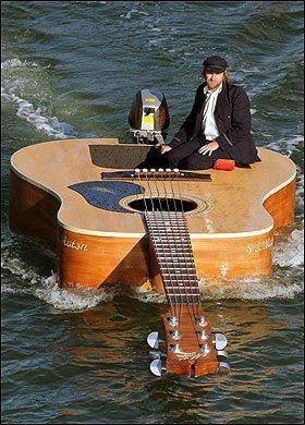 How about that!   It's a boat ....it's a guitar....  No, it is a guitar boat!
