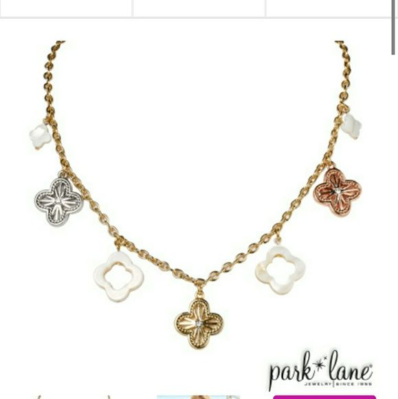 Aruba sunset necklace from Park Lane jewelry Short Gold chain necklace with flower shaped charms. Silver, gold, rose gold, gold , white. From park lane jewelry. In very good condition. Practically brand new. Willing to negotiate price Park Lane Jewelry Necklaces