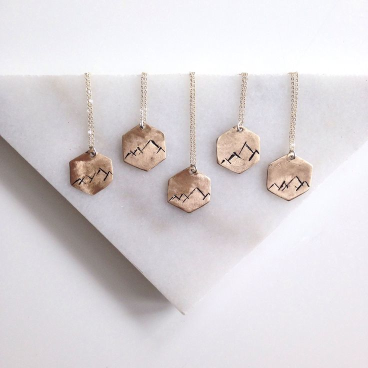 Love these necklaces -- the Hex Mountain Range Necklace  by Christina Nicole