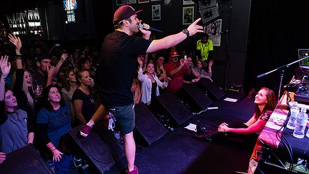 """WA- Hip hop artist Seth Sentry with Paralympian Kat O'Kelly-Kennedy after the crowd turned on her when she couldn't sit down during his concert.""""He realised what was going on and quickly asked if I'd like to sit on stage with him and DJ Sizzle, where there would be more space,"""" she said."""