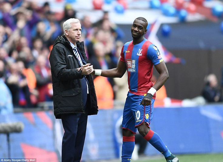 Bolasie runs over to celebrate the goal with Palace manager Alan Pardew (left) after he gave his team the perfect start to the clash