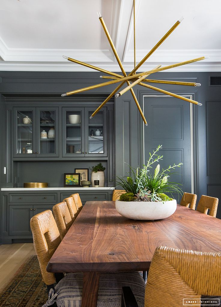 Amber Interiors // Charcoal Gray And Brass Dining Room