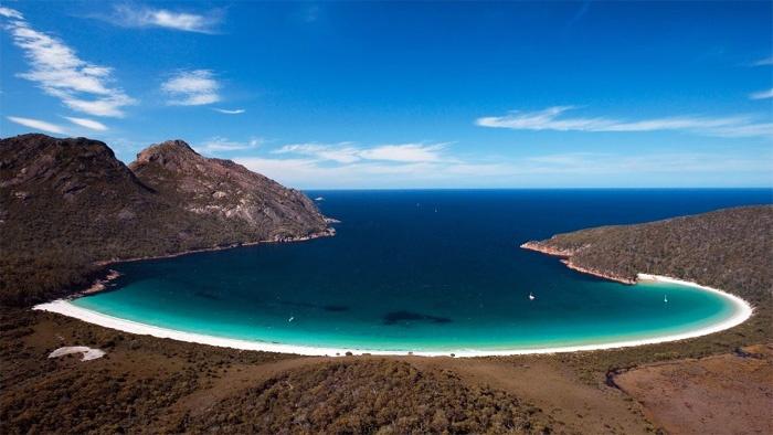 Wineglass Bay Freycinet National Park Tasmania.  Freycinet is a national park on the east coast of Tasmania, Australia, 125 km northeast of Hobart. It occupies a large part of the Freycinet Peninsula, named after French navigator Louis de Freycinet, and Schouten Island.