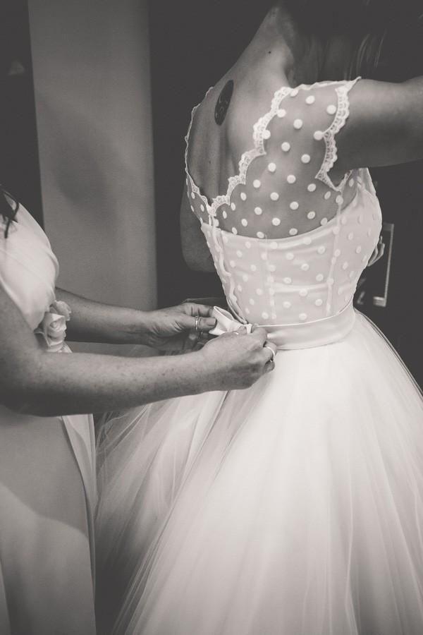 Bride in vintage wedding dress with polka dot overlay @myweddingdotcom