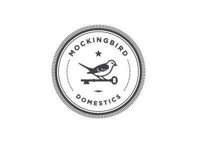 Mockingbird logo by Katie Daly. Love the bird/key imagery, and circular cartouche.