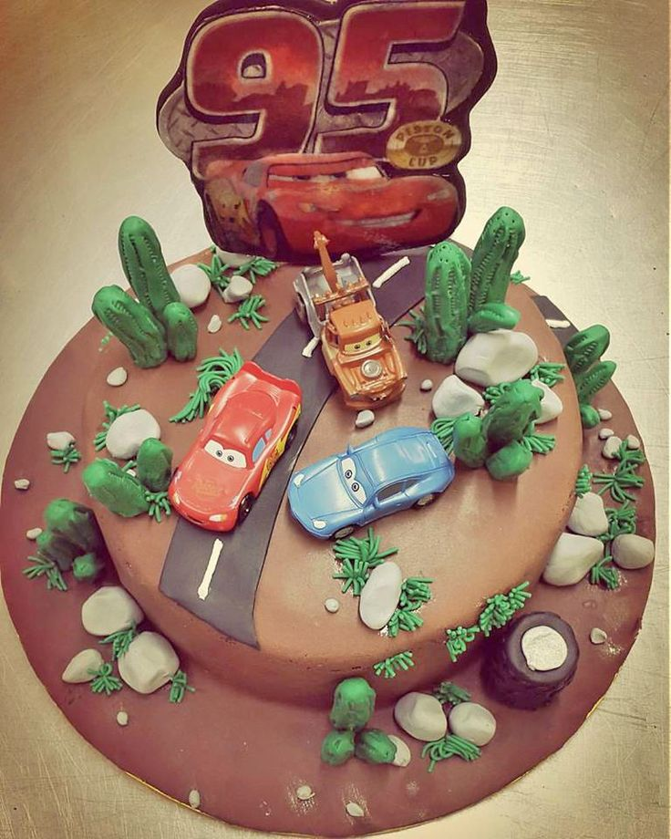"""A """"fast and furious"""" cake. Layers of choclate and chocolate buttercream frosting and a complicated sugar paste decoration on top."""