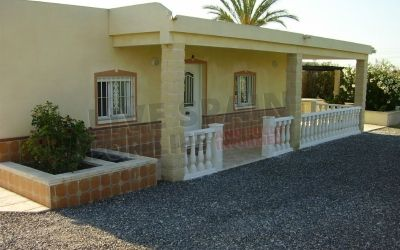 275000€ Lovely spacious 200m2 hacienda style property, built in 2005 on 12,400m2 of land. 4 bedrooms, 2 bathrooms one en-suite and one family bathroom. Fitted kitchen and bright roomy lounge Plus a study/hobby room. Large terrace which overlooks the 12 x 4m2 swimming pool. Next to the pool there is a BBQ house and large utility housing the exterior toilet facilities and separate boiler room.  To the rear is a large carport, a 4 car garage and a useful workshop.  Ref: Crev CJ2