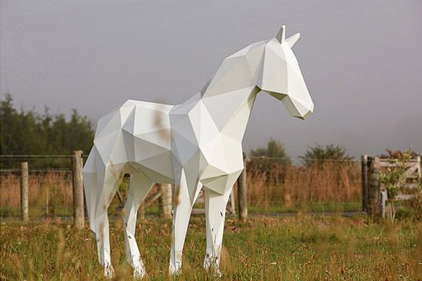 Stark White Animal Sculptures Contrast With Nature
