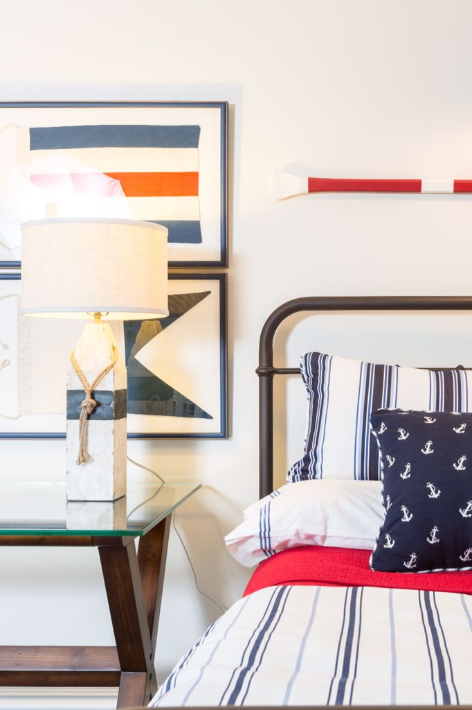 Boy's Nautical Inspired Bedroom by Reed & Acanthus Interior Design: Buoy  lamps and anchor pillows