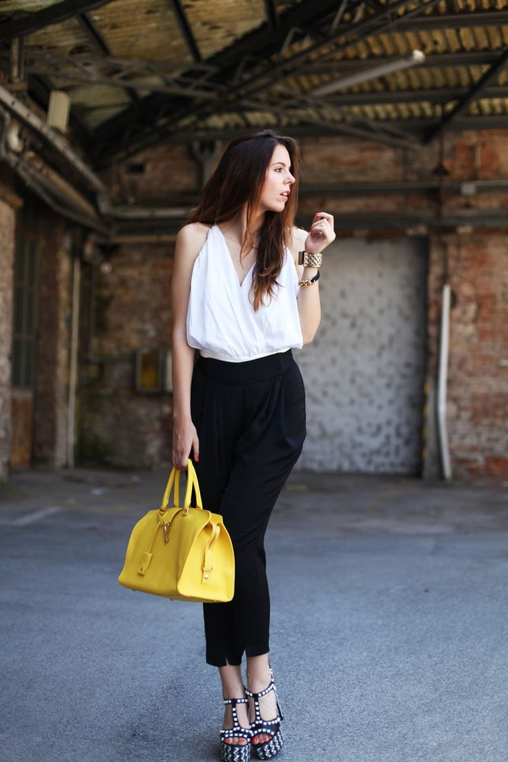 Today's casual look is a white backless top, black trousers, funky heels and a yellow YSL tote