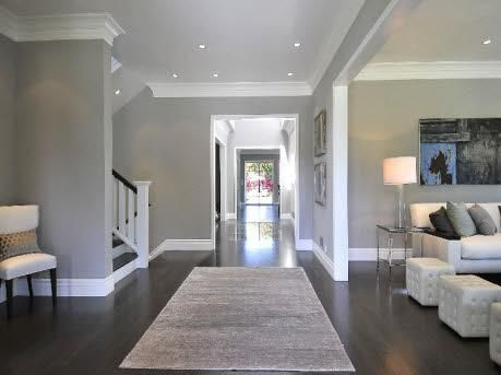 Dark Hardwood Floors, Grey Walls, White Molding/Baseboards