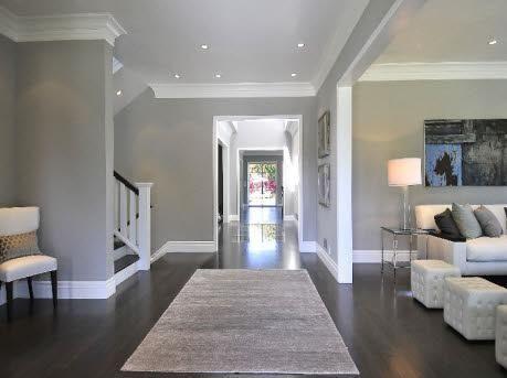 Dark Hardwood Floors, Grey Walls, White Molding/Baseboards
