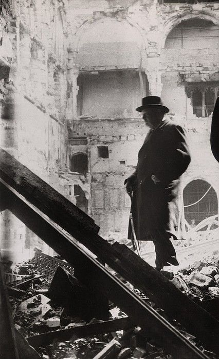 Winston Churchill inspecting bomb damage in the House of Commons debating chamber on May 11, 1941.