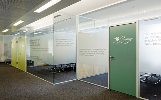 Corporate colors and company values / mission statement etched on glass. | Austria Tabak / Japan Tobacco International headquarters