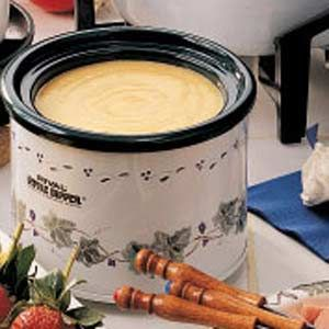 "Cheddar Fondue Recipe -""This cheesy blend, sparked with mustard and Worcestershire sauce, is yummy,"" relates field editor Norene Wright of Manilla, Indiana."