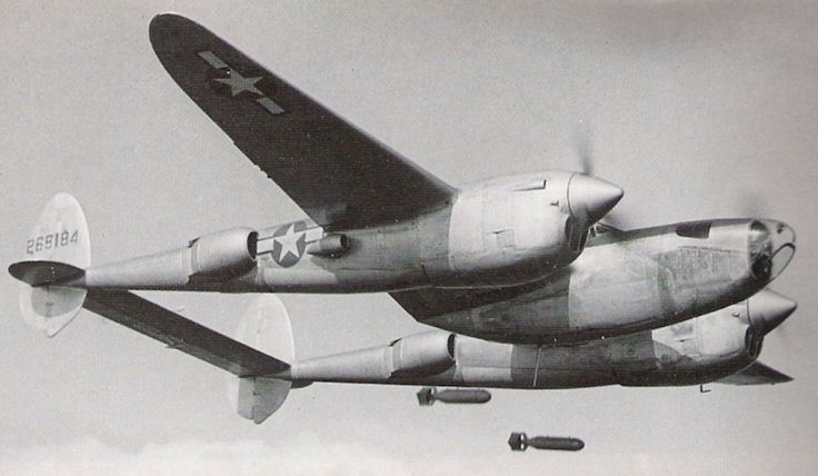 P-38J Lightning aircraft with the 'droop snoop' conversion in practice bombing, probably in the United States, 1943-1945.