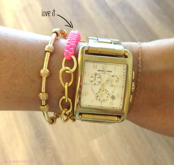 mixing and matching one's arm candy has become a bit of an art lately.  love this DYI gold and hot pink bracelet.
