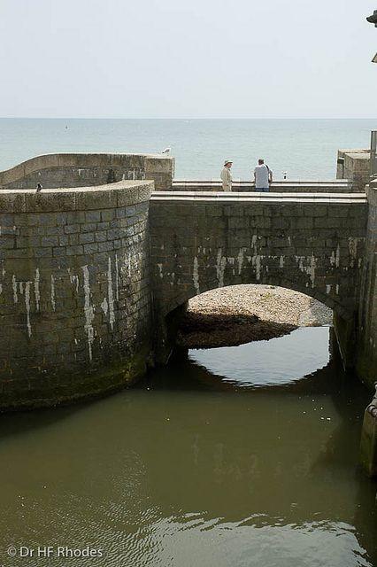 The River Lim entering the Sea, Lyme Regis, Dorset, England