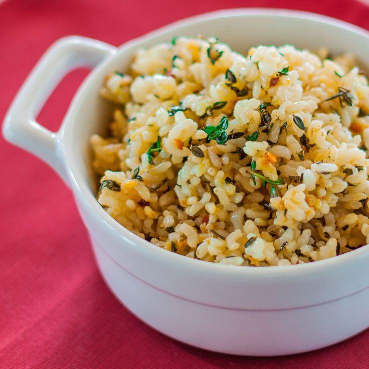 Lemon, garlic, and thyme make brown rice shine in this light, slightly-tart gluten-free, vegetarian dish. Red chili flakes add a nice kick.